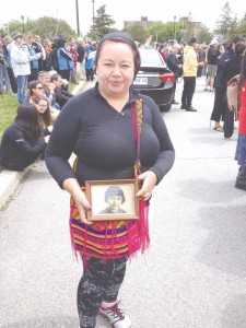 Jeannie Pelletier showing photo of her late mother Lillian Spencer